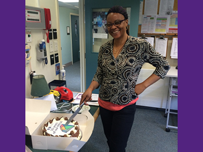 An NZNO midwife cuts the cake at Kenepuru' Hospital's 10th MECA bash.