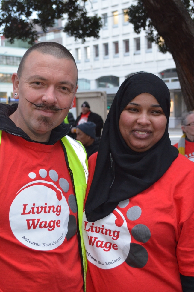 """Kieran Monaghan (left) and fellow Living Wage activist Naima Abdi at the """"Mop March"""" for Wellington City Council contract cleaners"""